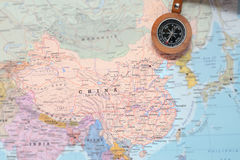Travel destination China, map with compass. Compass on a map pointing at China and planning a travel destination Royalty Free Stock Image