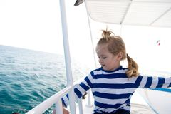 Travel destination, cruise, travelling. Adventure, discovery, wanderlust. Boy in sailor shirt sail in blue sea. Summer vacation concept. Child with blond hair Stock Images