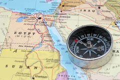 Travel destination Egypt, map with compass. Compass on a map pointing at Egypt, planning a travel destination royalty free stock images