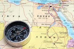 Travel destination Egypt, map with compass. Compass on a map pointing at Egypt, planning a travel destination royalty free stock photos