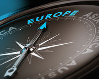 Travel destination - Europe. Abstract compass needle pointing the destination europe, blue and brown tones with focus on the main word. Concept image suitable vector illustration