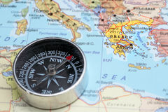 Travel destination Greece, map with compass. Compass on a map pointing at Greece, planning a travel destination stock images