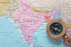Travel destination India, map with compass. Compass on a map pointing at India and planning a travel destination royalty free stock photo
