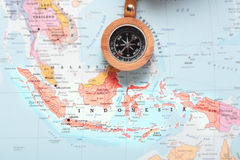 Travel destination Indonesia, map with compass. Compass on a map pointing at Indonesia and planning a travel destination royalty free stock photo