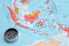 Travel destination Indonesia, map with compass. Compass on a map pointing at Indonesia and planning a travel destination stock photography