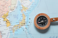Travel destination Japan, map with compass. Compass on a map pointing at Japan and planning a travel destination Stock Photos