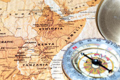 Travel destination Kenya, Ethiopia and Somalia, ancient map with vintage compass. Compass on a map pointing at Kenya, Ethiopia and Somalia, planning a travel royalty free stock images