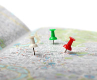Travel destination map push pins. Push pins pointing planned travel destinations on city map royalty free stock images