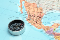 Travel destination Mexico, map with compass. Compass on a map pointing at Mexico and planning a travel destination stock photography