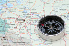 Travel destination Moscow Russia, map with compass. Compass on a map pointing at Russia and planning a travel with destination Moscow stock photography