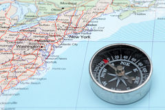 Travel destination New York United States, map with compass. Compass on a map pointing at United States and planning a travel with destination New York Royalty Free Stock Images