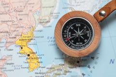 Travel destination North and South Korea, map with compass. Compass on a map pointing at North and South Korea, planning a travel destination stock photo