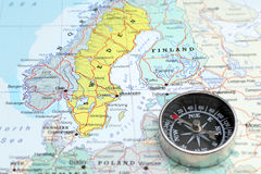 Travel destination Norway Sveden and Finland, map with compass. Compass on a map pointing at Norway Sveden and Finland, planning a travel destination in Stock Image