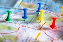 Travel destination pin points on a map with colorful thumbtacks Royalty Free Stock Image