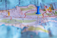 Travel destination pin points on a map with colorful thumbtacks Royalty Free Stock Photo