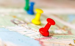 Travel destination points on a map indicated with colorful thumbtacks and shallow depth of field with space for copy.  royalty free stock images