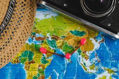Travel Destination Points on World Map Indicated with Colorful Thumbtacks, Red Ribbon and Shallow Depth of Field. Travel Destination Points on World Map Stock Images