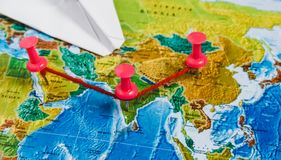 Travel Destination Points on World Map Indicated with Colorful Thumbtacks, Rope and Shallow Depth of Field. Travel Destination Points on World Map Indicated Stock Photos