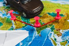Travel Destination Points on World Map Indicated with Colorful Thumbtacks, Rope and Shallow Depth of Field. Travel Destination Points on World Map Indicated Stock Images
