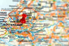 Travel destination Rotterdam. Closeup of a road map with pin point destination and blurred surroundings Royalty Free Stock Photos