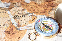 Travel destination Saudi Arabia, ancient map with vintage compass. Compass on a map pointing at Saudi Arabia, planning a travel destination Stock Photos