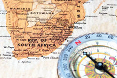 Travel destination South Africa, ancient map with vintage compass. Compass on a map pointing at South Africa, planning a travel destination Royalty Free Stock Images
