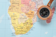 Travel destination South Africa, map with compass. Compass on a map pointing at South Africa and planning a travel destination Stock Images