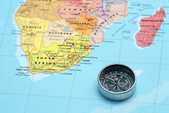 Travel destination South Africa, map with compass. Compass on a map pointing at South Africa and planning a travel destination Royalty Free Stock Photos
