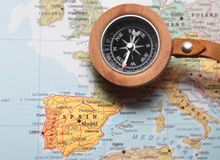 Travel destination Spain, map with compass. Compass on a map pointing at Spain and planning a travel destination Stock Photo