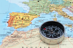 Travel destination Spain, map with compass. Compass on a map pointing at Spain and planning a travel destination Royalty Free Stock Image