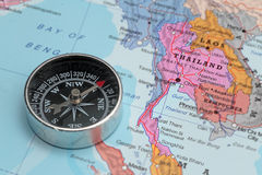 Travel destination Thailand, map with compass. Compass on a map pointing at Thailand and planning a travel destination royalty free stock images