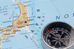 Travel destination Tokyo Japan, map with compass. Compass on a map pointing at Japan and planning a travel with destination Tokyo stock photography