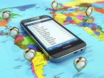 Travel destination and tourism concept. Smartphone on world map Stock Images