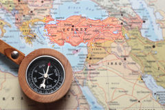 Travel destination Turkey, map with compass. Compass on a map pointing at Turkey and planning a travel destination royalty free stock photos