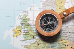 Travel destination United Kingdom and Ireland, map with compass. Compass on a map pointing at United Kingdom and Ireland, planning a travel destination Stock Photography