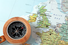 Travel destination United Kingdom and Ireland, map with compass. Compass on a map pointing at United Kingdom and Ireland, planning a travel destination Royalty Free Stock Photography