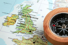 Travel destination United Kingdom and Ireland, map with compass. Compass on a map pointing at United Kingdom and Ireland, planning a travel destination Royalty Free Stock Images