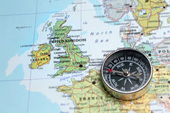 Travel destination United Kingdom and Ireland, map with compass. Compass on a map pointing at United Kingdom and Ireland, planning a travel destination Stock Photos