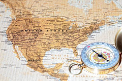 Travel destination United States, ancient map with vintage compass. Compass on a map pointing at United States, planning a travel destination Stock Photography