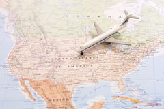 Travel destination USA. Passenger airplane miniature on a map Stock Photography