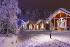 Travel Destinations Concepts. Line of Traditional Lapland Suomi Houses. At Polar Circle in Finland at Christmas Time in Finland.Horizontal Shot Stock Photos