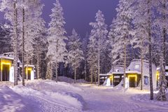 Travel Destinations Concepts. Traditional Nordic Suomi Houses. Over the Polar Circle in Finland at Christmas Time. Located in Front of Amazing Winter Forest Royalty Free Stock Image