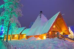 Travel Destinations Concepts. Unique Lapland Suomi Houses Over t. He Polar Circle in Finland at Christmas Time. Located in Front of Amazing Winter Forest Scenery Royalty Free Stock Photo