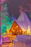 Travel Destinations Concepts. Unique Lapland Suomi Houses. Over the Polar Circle in Finland at Christmas Time. Located in Front of Amazing Winter Forest Scenery Stock Images