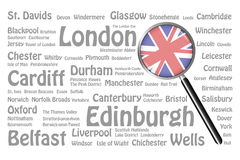 Travel destinations of Great Britain Concept. The magnifying glass with the UK flag is on the right side of the vector. The background consists of the gray names royalty free illustration