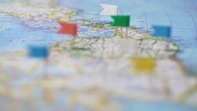 Travel destinations in North America marked with pins on world map, tourism. Stock footage stock footage