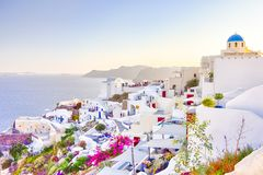 Travel Destinations. People Preparing for Sunset at Caldera Volcanic Slope of Oia Village in Santorini Island in Greece. Horizontal Image stock photos