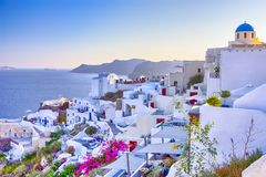 Travel Destinations. People Preparing for Sunset at Caldera Volcanic Slope of Oia Village in Santorini Island in Greece. Horizontal Image Composition stock photo