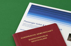 Travel documents. Passenger ticket and German passport Royalty Free Stock Image