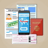 Travel documents concept. International passport, approved visa application, insurance certificate, smartphone with booking app and boarding pass ticket. Travel Royalty Free Stock Photography
